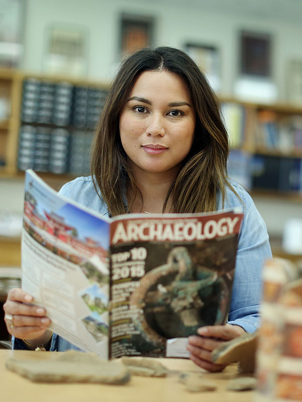 Student reading an archaeology magazine