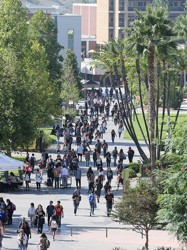Students walking on the Main Walkway at Cal State LA