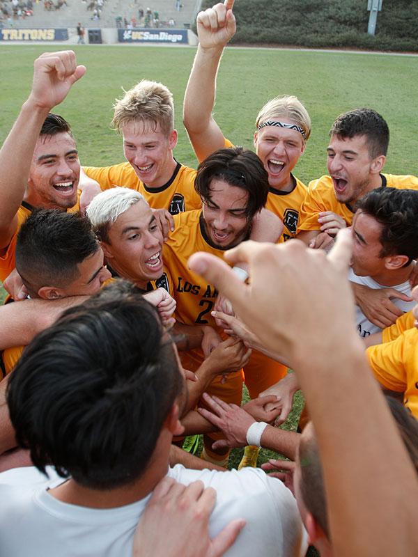 Men's soccer celebration